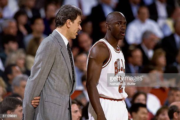 Head Coach Phil Jackson of the Chicago Bulls has some words for Michael Jordan of the Chicago Bulls during a game circa 1991 at the United Center in...