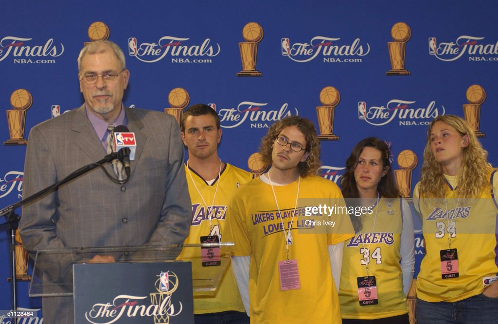 Head Coach Phil Jackson of the Los Angeles Lakers and his children attend a postgame press conference after Game Five of the 2004 NBA Finals on June 15, 2004 at The Palace of Auburn Hills in Auburn Hills, Michigan.