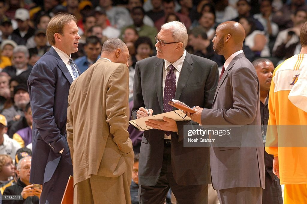 Head coach Phil Jackson the Los Angeles Lakers talks to his assistant coaches Kurt Rambis Jim Cleamons and Brian Shaw during the game against the...