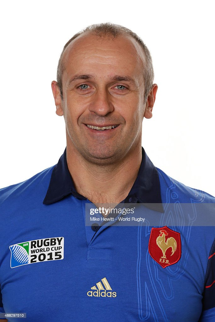 Head coach <a gi-track='captionPersonalityLinkClicked' href=/galleries/search?phrase=Philippe+Saint-Andre&family=editorial&specificpeople=2172154 ng-click='$event.stopPropagation()'>Philippe Saint-Andre</a> of France poses during the France Rugby World Cup 2015 squad photo call at the Selsdon Park Hotel on September 15, 2015 in Croydon, England.