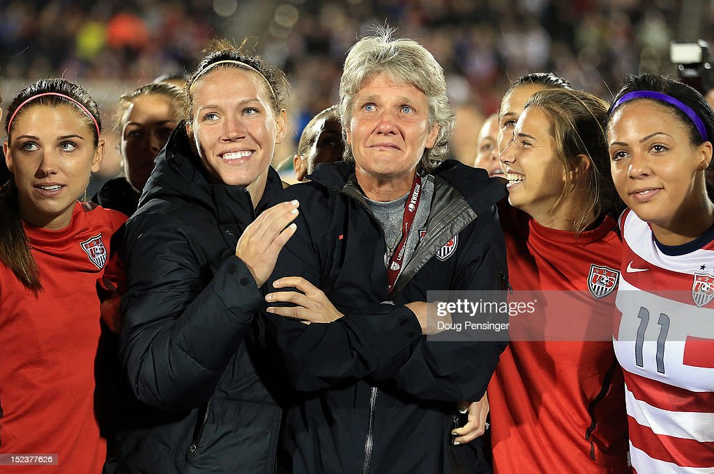 Head coach <a gi-track='captionPersonalityLinkClicked' href=/galleries/search?phrase=Pia+Sundhage&family=editorial&specificpeople=3280218 ng-click='$event.stopPropagation()'>Pia Sundhage</a> (C) for the USA is surrounded by her players during a post game tribute after she coached her final game for the USA as they defeated Australia 6-2 at Dick's Sporting Goods Park on September 19, 2012 in Commerce City, Colorado.