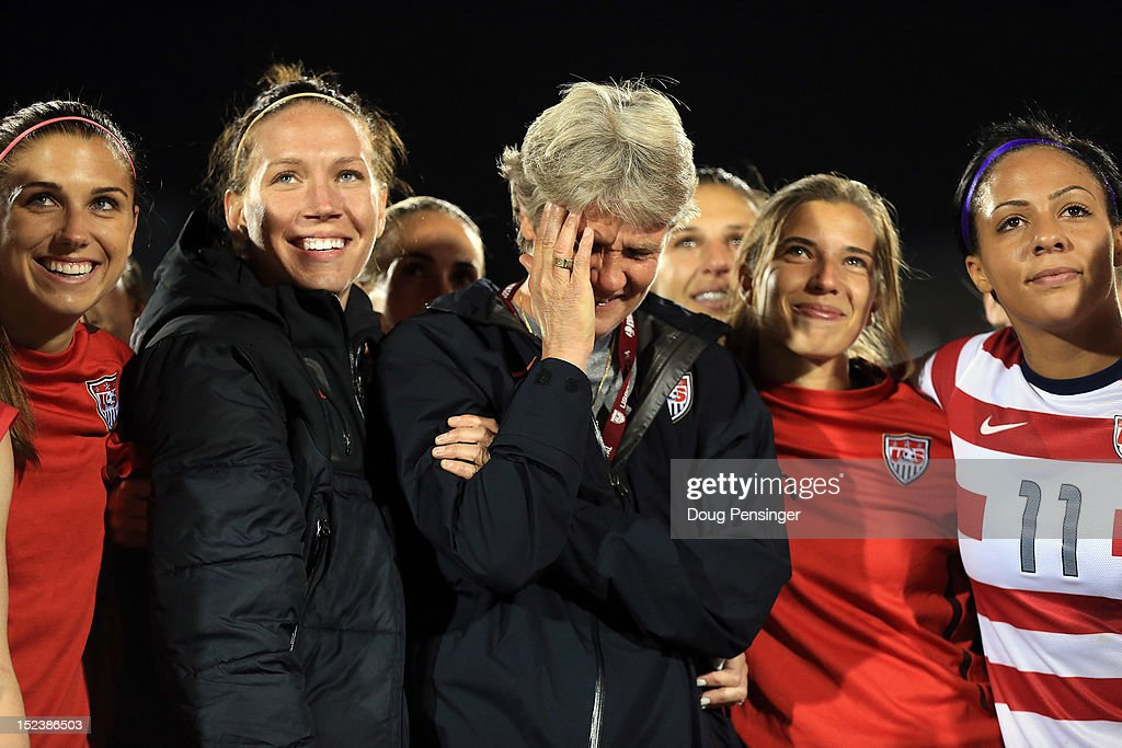 Head coach <a gi-track='captionPersonalityLinkClicked' href=/galleries/search?phrase=Pia+Sundhage&family=editorial&specificpeople=3280218 ng-click='$event.stopPropagation()'>Pia Sundhage</a> (C) for the USA is surrounded by her players during a post game tribute after she coached her final game for the USA and defeated Australia 6-2 at Dick's Sporting Goods Park on September 19, 2012 in Commerce City, Colorado.