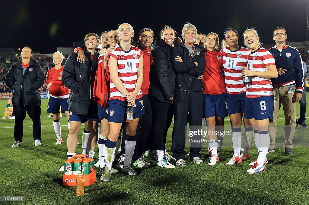 Head coach <a gi-track='captionPersonalityLinkClicked' href=/galleries/search?phrase=Pia+Sundhage&family=editorial&specificpeople=3280218 ng-click='$event.stopPropagation()'>Pia Sundhage</a> for the USA is surrounded by her players during a post game tribute after she coached her final game for the USA and defeated Australia 6-2 at Dick's Sporting Goods Park on September 19, 2012 in Commerce City, Colorado.