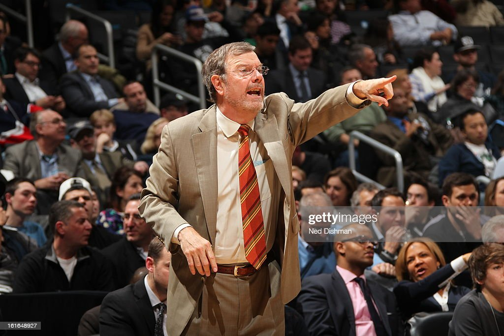 Head Coach P.J. Carlesimo of the Brooklyn Nets directs his players from the sidelines against the Denver Nuggets at the Barclays Center on February 13, 2013 in the Brooklyn borough of New York City in New York City.