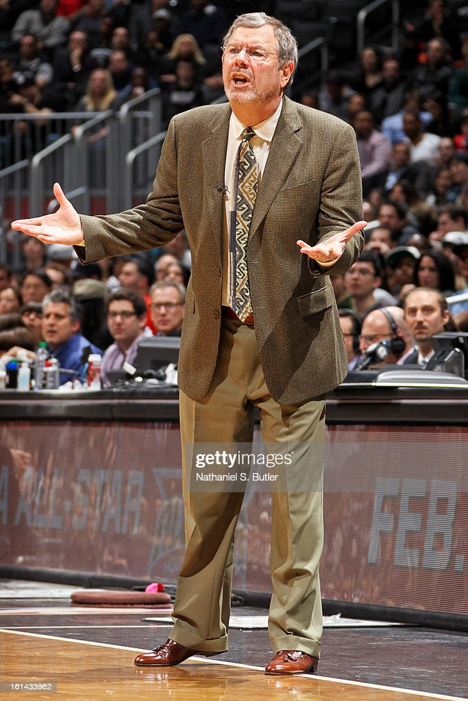 Head Coach <a gi-track='captionPersonalityLinkClicked' href=/galleries/search?phrase=P.J.+Carlesimo&family=editorial&specificpeople=243247 ng-click='$event.stopPropagation()'>P.J. Carlesimo</a> of the Brooklyn Nets directs his team against the San Antonio Spurs on February 10, 2013 at the Barclays Center in the Brooklyn borough of New York City.