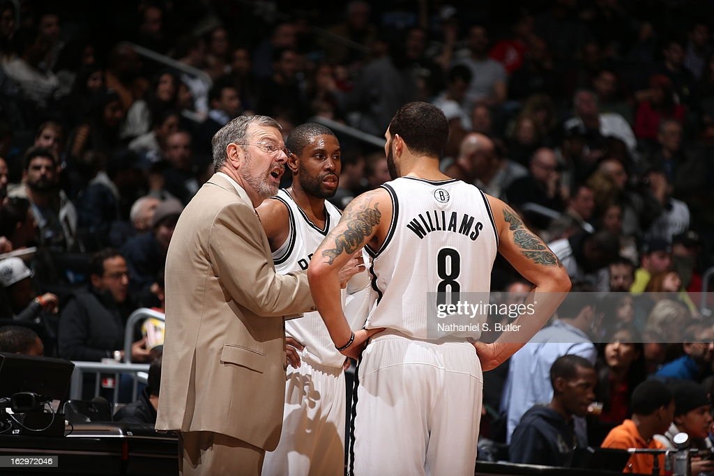 Head Coach <a gi-track='captionPersonalityLinkClicked' href=/galleries/search?phrase=P.J.+Carlesimo&family=editorial&specificpeople=243247 ng-click='$event.stopPropagation()'>P.J. Carlesimo</a> of the Brooklyn Nets gives direction to his players during a timeout against the Memphis Grizzlies on February 24, 2013 at the Barclays Center in the Brooklyn borough of New York City.