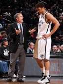 Head Coach PJ Carlesimo of the Brooklyn Nets instructs Brook Lopez in Game Two of the Eastern Conference Quarterfinals against the Chicago Bulls...
