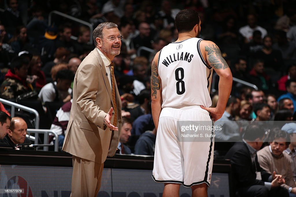 Head coach P.J. Carlesimo of the Brooklyn Nets talks to Deron Williams #8 of the Brooklyn Nets on February 24, 2013 at the Barclays Center in the Brooklyn borough of New York City.