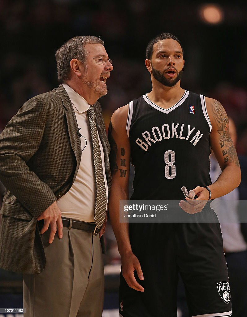 Head coach PJ Carlesimo of the Brooklyn Nets talks with Deron Williams as the Nets take on the Chicago Bulls in Game Three of the Eastern Conference...