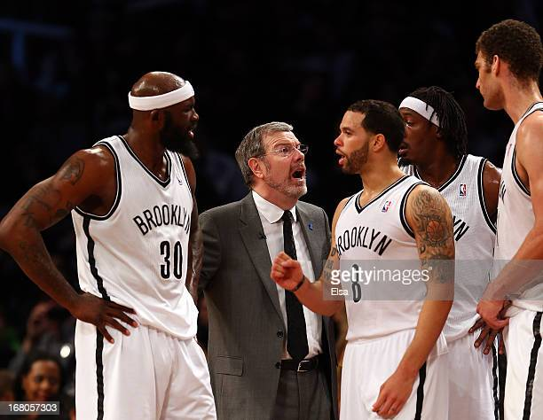 Head coach PJ Carlesimo of the Brooklyn Nets talks with players Reggie Evans Deron Williams Gerald Wallace and Brook Lopez during a timeout in the...