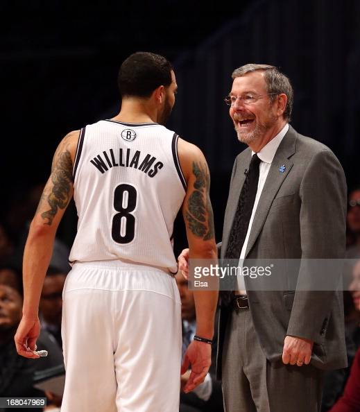 Head coach PJ Carlesimo talks with Deron Williams of the Brooklyn Nets during a stop in play in the first quarter against the Chicago Bulls during...