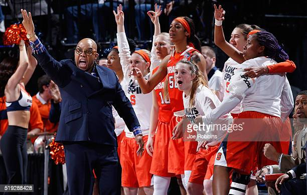Head coach Quentin Hillsman of the Syracuse Orange and players react in the first quarter against the Connecticut Huskies during the championship...
