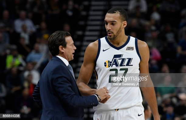 Head coach Quin Snyder of the Utah Jazz talks with his player Rudy Gobert in the first half of their preseason game against the Sydney Kings at...