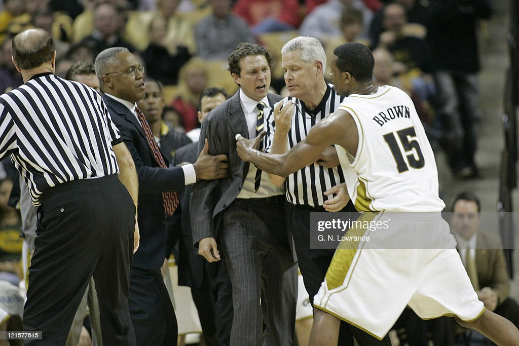 Head coach Quin Synder of the Missouri Tigers gives a referee an earful during 2nd half action against the Iowa State Cyclones at Mizzou Arena in...