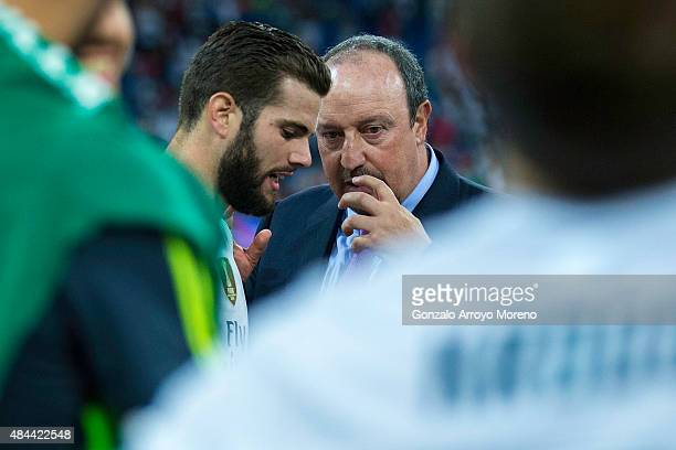 Head coach Rafael Benitez of Real Madrid CF speaks with player Nacho Fernandez after the Santiago Bernabeu Trophy match between Real Madrid CF and...