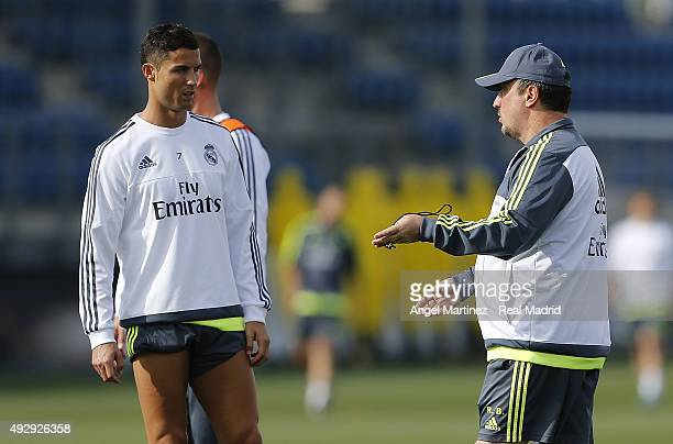 Head coach Rafael Benitez of Real Madrid talks to Cristiano Ronaldo during a training session at Valdebebas training ground on October 16 2015 in...