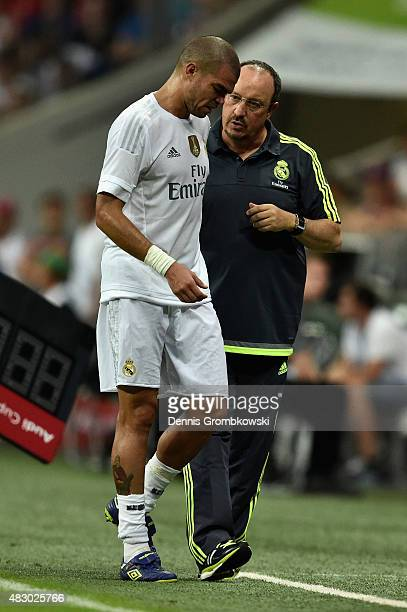 Head coach Rafael Benitez of Real Madrid talks to Pepe during the Audi Cup 2015 Final between FC Bayern Muenchen and Real Madrid at Allianz Arena on...
