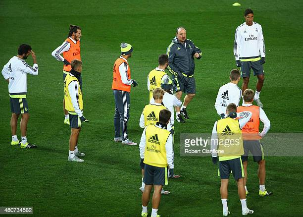Head coach Rafael Benitez speaks to his players during Real Madrid training session at Melbourne Cricket Ground on July 15 2015 in Melbourne Australia