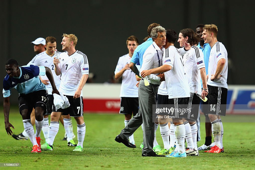 Head coach <a gi-track='captionPersonalityLinkClicked' href=/galleries/search?phrase=Rainer+Adrion&family=editorial&specificpeople=2380316 ng-click='$event.stopPropagation()'>Rainer Adrion</a> of Germany hugs <a gi-track='captionPersonalityLinkClicked' href=/galleries/search?phrase=Kevin+Volland&family=editorial&specificpeople=6001755 ng-click='$event.stopPropagation()'>Kevin Volland</a> after the UEFA European U21 Championship Group B match between Russia and Germany at Netanya Stadium on June 12, 2013 in Netanya, Israel.