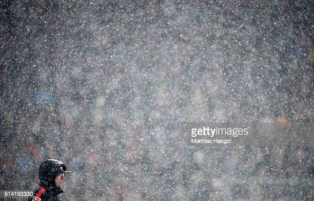 Head coach Ralf Rangnick of RB Leipzig stands in the snow storm during the Second Bundesliga match between SC Freiburg and RB Leipzig at...