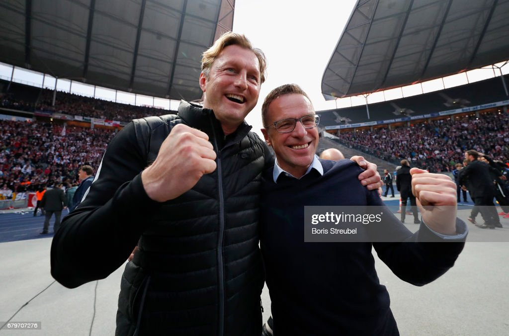Head coach Ralph Hasenhuettl and Ralf Rangnick of RB Leipzig celebrate the participation of the UEFA Champions League in the next season after winning the Bundesliga match between Hertha BSC and RB Leipzig at Olympiastadion on May 6, 2017 in Berlin, Germany.