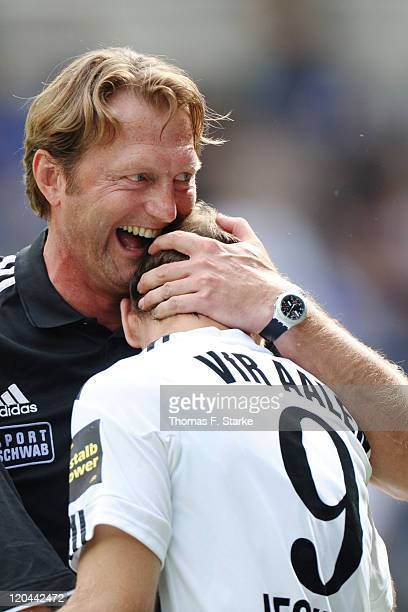 Head coach Ralph Hasenhuettl and Robert Lechleiter of Aalen celebrate after the Third League match between Arminia Bielefeld and VfR Ahlen at the...
