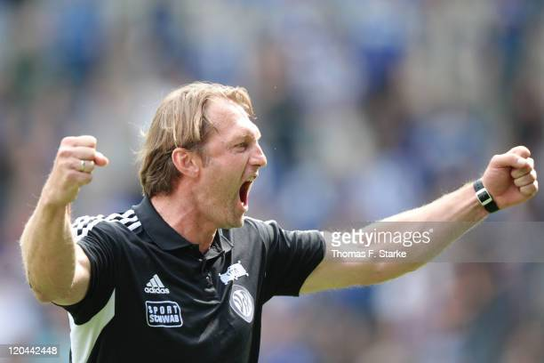 Head coach Ralph Hasenhuettl of Aalen celebrates after the Third League match between Arminia Bielefeld and VfR Ahlen at the Schueco Arena on August...