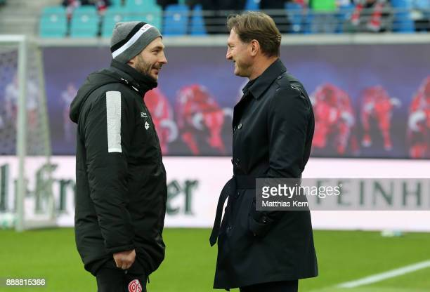 Head coach Ralph Hasenhuettl of Leipzig and head coach Sandro Schwarz of Mainz look on prior to the Bundesliga match between RB Leipzig and 1FSV...