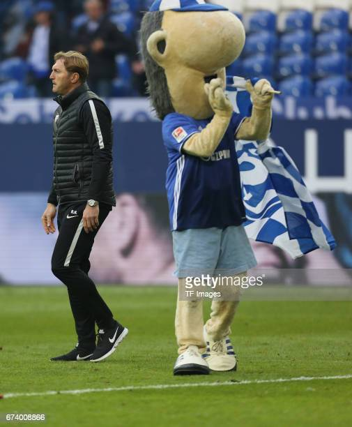 Head coach Ralph Hasenhuettl of Leipzig and Mascot of Schalke Erwin is seen during the Bundesliga match between FC Schalke 04 and RB Leipzig at...