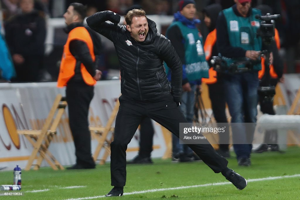 Head coach Ralph Hasenhuettl of Leipzig celebrate after the final whistle of the Bundesliga match between Bayer 04 Leverkusen and RB Leipzig at BayArena on November 18, 2016 in Leverkusen, Germany.