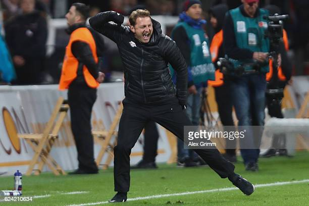 Head coach Ralph Hasenhuettl of Leipzig celebrate after the final whistle of the Bundesliga match between Bayer 04 Leverkusen and RB Leipzig at...