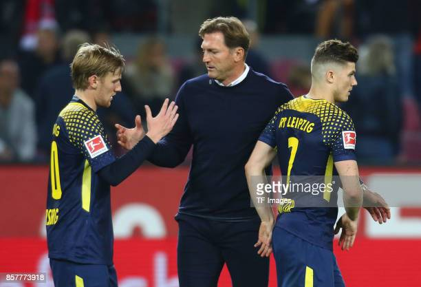 Head coach Ralph Hasenhuettl of Leipzig shakes hands with Emil Forsberg of Leipzig and Marcel Sabitzer nach dem Spiel during the Bundesliga match...