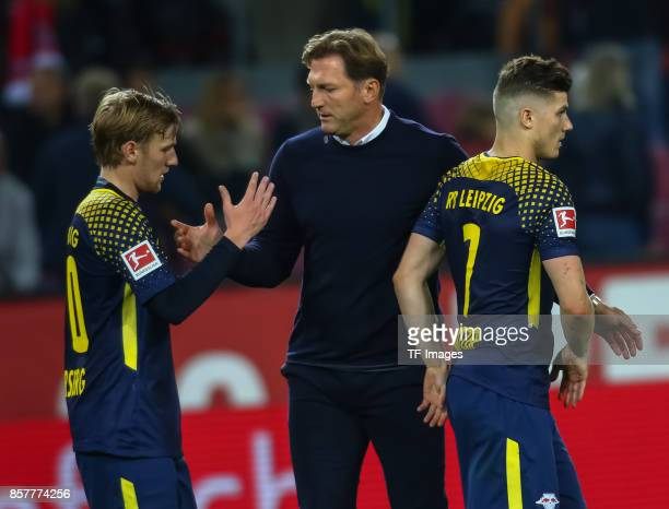 Head coach Ralph Hasenhuettl of Leipzig shakes hands with t Marcel Sabitzer and Emil Forsberg during the Bundesliga match between 1 FC Koeln and RB...