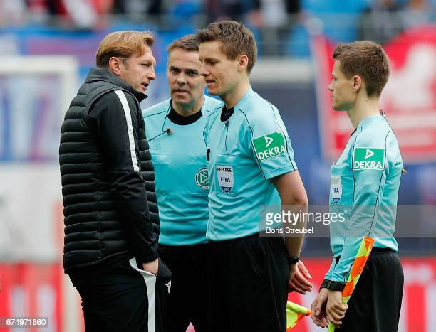 Head coach Ralph Hasenhuettl of RB Leipzig talks with referee Daniel Siebert after the Bundesliga match between RB Leipzig and FC Ingolstadt 04 at...
