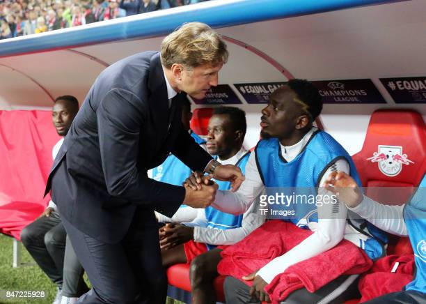 Head coach Ralph Hasenhuettl shakes hands with Yvon Lar Mvogo Nganoma of Leipzig during the UEFA Champions League group G match between RB Leipzig...