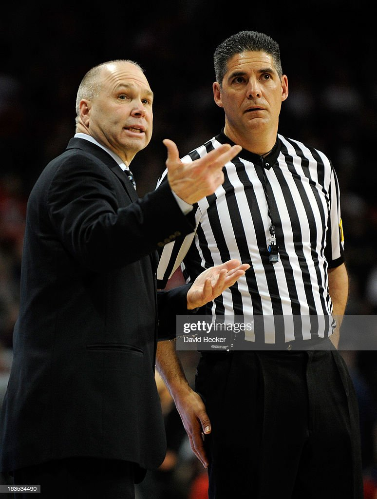 Head coach Randy Bennett (L) of the Saint Mary's Gaels speaks to a referee during the championship game of the West Coast Conference Basketball tournament against the Gonzaga Bulldogs at the Orleans Arena March 11, 2013 in Las Vegas, Nevada. Gonzaga won 65-51.
