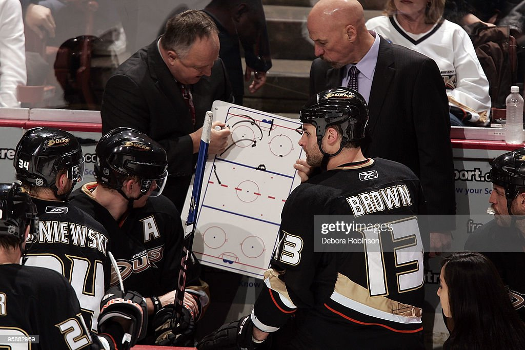 Head coach Randy Carlyle of the Anaheim Ducks draws a play on the white board during a break in action during the game against the Buffalo Sabres during the game on January 19, 2010 at Honda Center in Anaheim, California.
