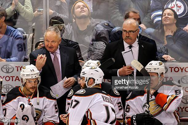 Head Coach Randy Carlyle of the Anaheim Ducks gives instructions to his players during a third period stoppage in play against the Winnipeg Jets at...