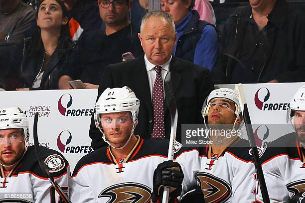 Head Coach Randy Carlyle of the Anaheim Ducks look son from the bench against the New York Islanders at the Barclays Center on October 16 2016 in...
