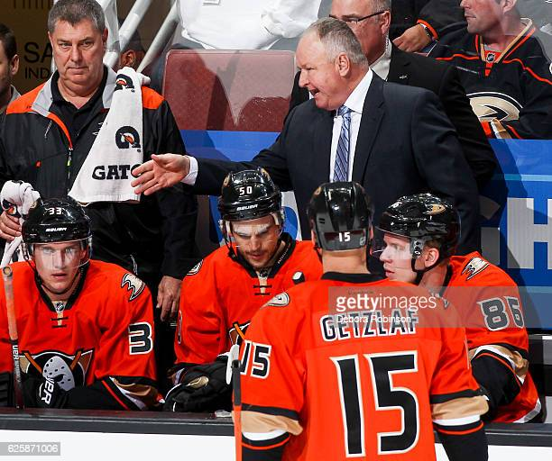 Head coach Randy Carlyle of the Anaheim Ducks talks to his players during a timeout in the game against the Los Angeles Kings at Honda Center on...