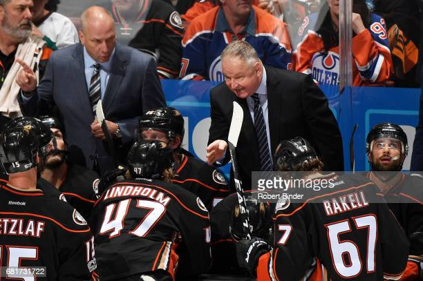 Head coach Randy Carlyle of the Anaheim Ducks talks to his players during a time out of Game Seven of the Western Conference Second Round against the...