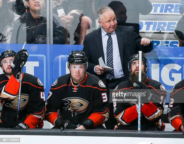 Head coach Randy Carlyle of the Anaheim Ducks talks to his team during the game against the Chicago Blackhawks at Honda Center on April 6 2017 in...