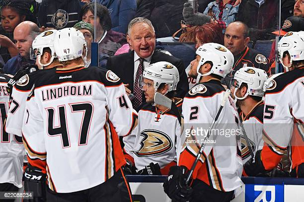 Head Coach Randy Carlyle of the Anaheim Ducks talks with his players during a timeout in the first period of a game against the Columbus Blue Jackets...