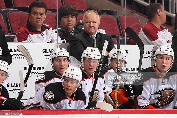 Head coach Randy Carlyle of the Anaheim Ducks watches from the bench during the preseason NHL game against Arizona Coyotes at Gila River Arena on...