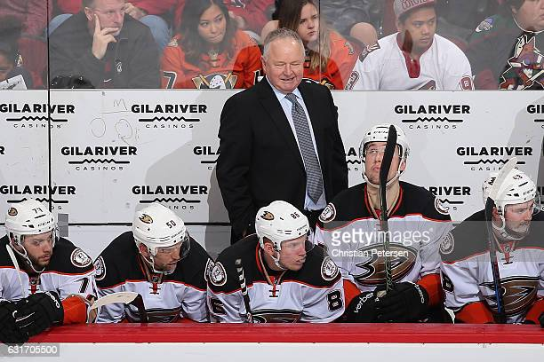 Head coach Randy Carlyle of the Anaheim Ducks watches from the bench during the second period of the NHL game against the Arizona Coyotes at Gila...