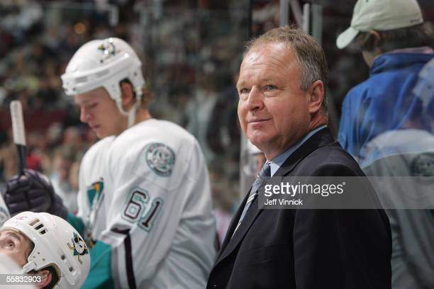 Head coach Randy Carlyle of the Mighty Ducks of Anaheim watches the action from behind the players bench during a preseason NHL game against the...