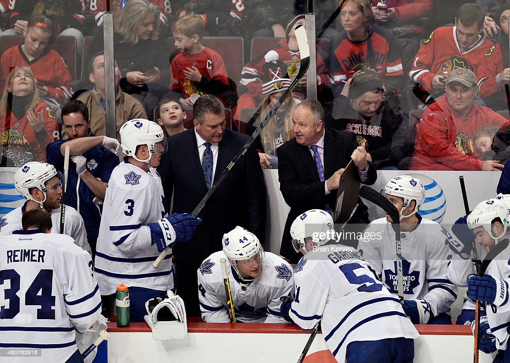 Head coach Randy Carlyle of the Toronto Maple Leafs draws up a play during a timeout in the third period against the Chicago Blackhawks at the United...
