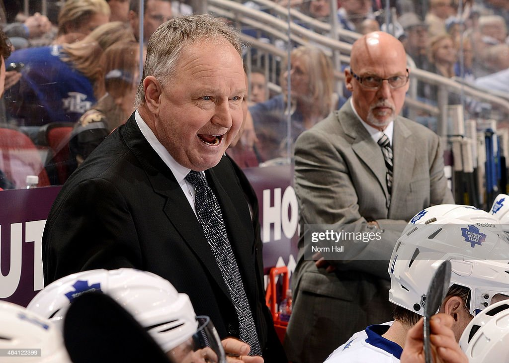 Head coach Randy Carlyle of the Toronto Maple Leafs gives instruction to his bench players during the third period against the Phoenix Coyotes at...