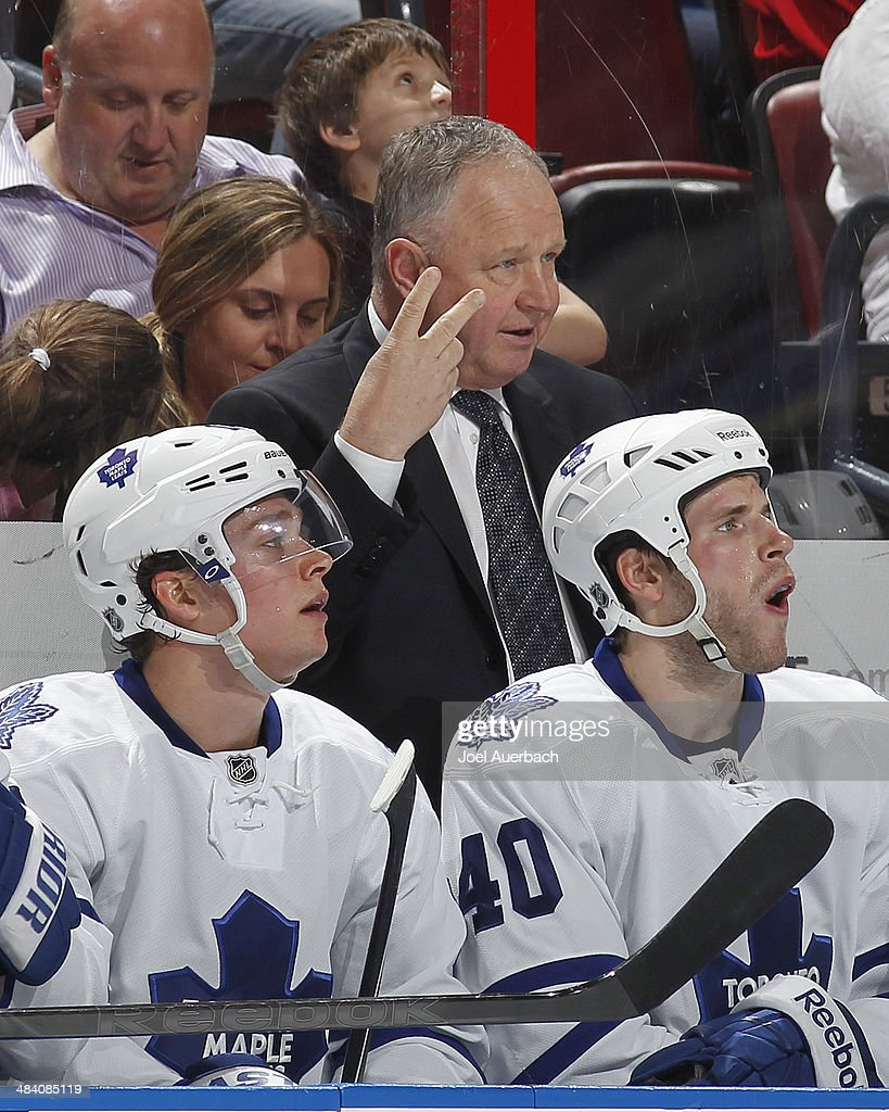 Head coach Randy Carlyle of the Toronto Maple Leafs holds up two fingers after a five minute fighting penalty was handed out during second period...