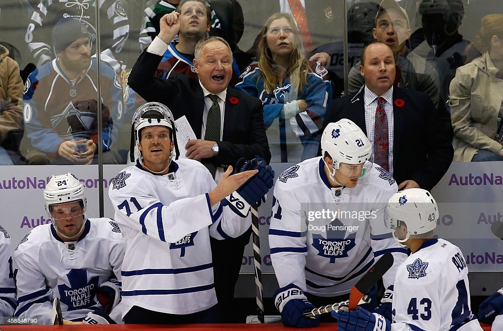 Head coach Randy Carlyle of the Toronto Maple Leafs leads his team against the Colorado Avalanche at Pepsi Center on November 6 2014 in Denver...
